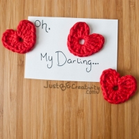 """Oh, My Darling"" note, surrounded by red hearts"